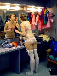 """After staking out her corner in the Green Room above the ballroom, Danielle Baker gets ready for the """"Barbie Girl"""" number. That piece was among 18 three-minute long songs that various student performers lip-synced to Saturday night in front of over 750 people. (Eugene OR, 2007)"""