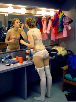 "After staking out her corner in the Green Room above the ballroom, Danielle Baker gets ready for the ""Barbie Girl"" number. That piece was among 18 three-minute long songs that various student performers lip-synced to Saturday night in front of over 750 people. (Eugene OR, 2007)"
