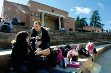 Megan Doyle, 14, left, and Aurelie Moilin, 14, eat lunch on the steps of the amphitheater at Roseville High School. The outdoor theater was donated by the class of 1931. (Roseville CA, 2008)