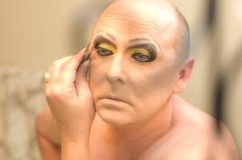 """A few hours before a private performance, Tonya Rose begins the transformation from Cecil, her given name, into Tonya Rose. """"I was raped as Cecil. But as Tonya, I am hidden in my mask so I can be who Cecil used to be: cheerful, outgoing and very social. In a way, the rape killed me."""" (OR, 2007)"""