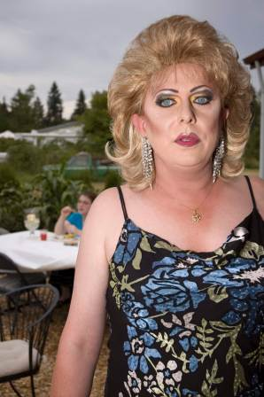 In full drag, Tonya takes a break at a private party at which she is the night's entertainment. Before being diagnosed with HIV, Tonya was active in the gay pageantry circuit and performing as Darcelle Showbar. She has had to quit since then, as she could no longer travel the country for coronations and performances, but she still tries to stay active with pageantry by designing sets and costumes, as well as the occasional charity benefit, such as performing at the Eugene, OR, Hult Center to raise money for the HIV Alliance. (OR, 2007)