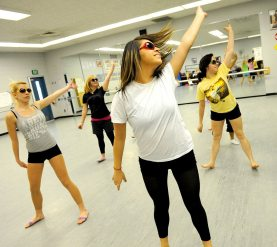 """Thannia Gonzalez works it for the """"Just Dance"""" piece at Woodcreek High School. (Roseville CA, 2009)"""
