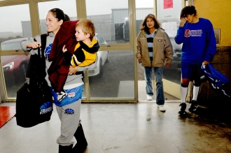 Rebekah Calvert arrives at practice last week with son Maximo in tow as her mother Val, middle, looks on. Calvert says she wouldn't be able to juggle school and basketball without the support of her family. (Rocklin CA, 2009)