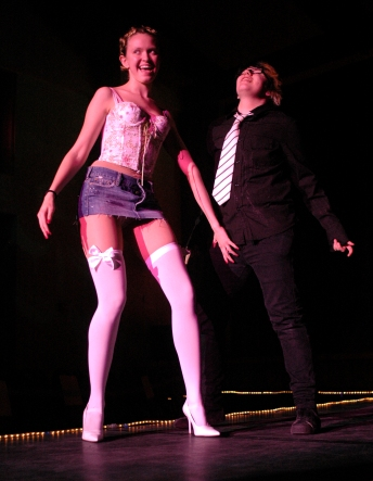 """Placing her hand suggestively on McGinnis's pants to go along with the lyrics, """"Touch me there, hanky panky,"""" Baker struts her stuff down the catwalk after her partner tore off her shirt; shortly after, she was stripped of her skirt, too. After two weeks of flakey group members and grueling preparation, the performance finally ended, and as she walked off stage of her final drag show performance, Baker exuberantly shouted, """"I'm done!"""" Yet, she says she'll miss it after she graduates: """"It may be stressful, but it's still exciting and I love performing."""" (Eugene or, 2007)"""