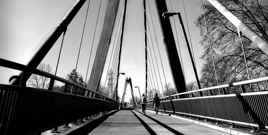 A black and white photo of the bridge at Alton Baker Park in Eugene, Oregon.